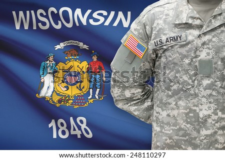 American soldier with US state flag on background - Wisconsin - stock photo