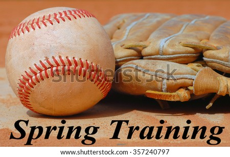 American sport of baseball image of close up view with old, rough baseball and worn leather mitt, or glove. Equipment is laying in the clay on top of home base. Spring training text - stock photo