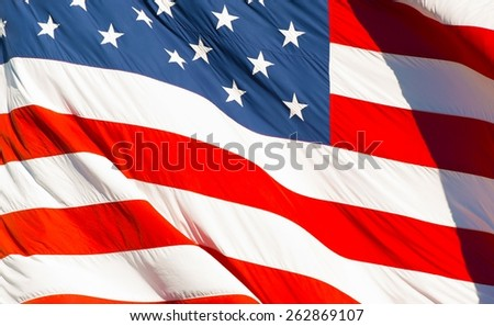American Textile Flag Waving in the Wind. USA Flag Background. - stock photo