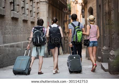 American tourists walking the street and watching landmark - stock photo