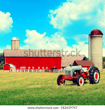 American Traditional Country Farm with Blue Cloudy Sky - stock photo