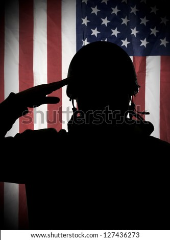 American (USA) soldier saluting to USA flag - stock photo