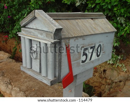 American wood mailbox with flag down - stock photo