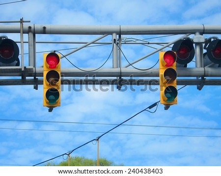 American yellow traffic and train rail lights on blue sky  - stock photo