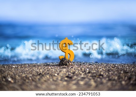Amerikan Dollar currency icon is standing on the wavy sea side - stock photo