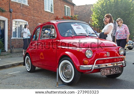 AMERSHAM, UK - SEPTEMBER 7: An immaculately turned out classic Fiat 500  motorcar stands on public display at the annual Amersham Heritage Day show on September 7, 2014 in Amersham - stock photo