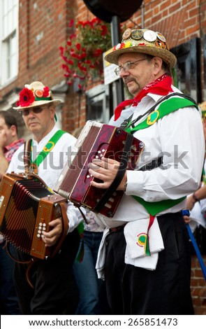 AMERSHAM, UK - SEPTEMBER 7: As part of the entertainment at the annual Amersham Heritage day event Morris dancers demonstrate old English folk dancing to the public on September 7, 2014 in Amersham - stock photo