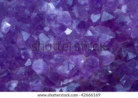 amethyst crystal stone detail of a textured surface - stock photo