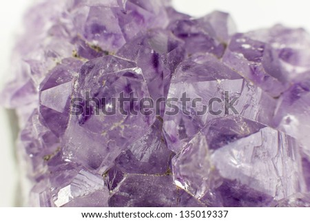 amethyst stone close up with white background - stock photo