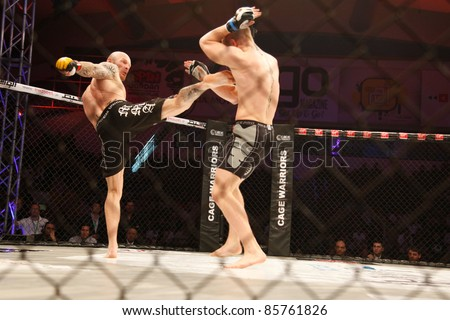 AMMAN, JORDAN - SEPTEMBER 8 : Conor Mcgregor (Right) defeats Aron Jahnsen (Left) by Knockout at 3:29 of Round 1, Cage Warriors Fight Night 2, Fight Card on September 8, 2011 in Amman, Jordan - stock photo