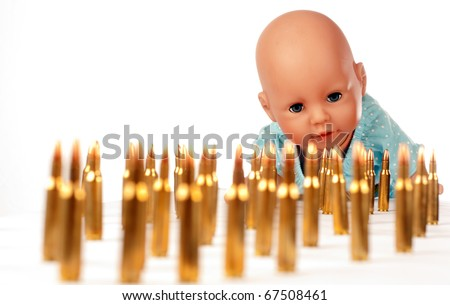 ammunition and a doll - stock photo