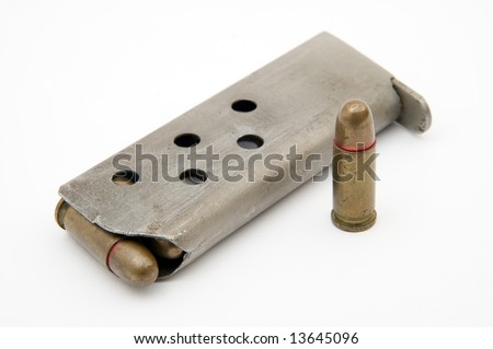 ammunition magazine and a single bullet isolated on white background - stock photo