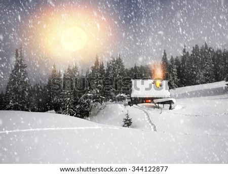 Among the legendary mountains of Eastern Europe Ukraine, forgotten pasture - are ancient houses of shepherds and hunters, covered with snow, where tourists rarely come travelers climbers on the top  - stock photo