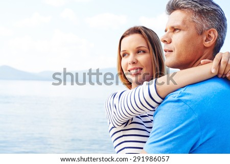 Amorous couple having romantic vacation by the sea - stock photo