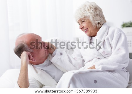 Amorous senior couple spending together pleasant morning - stock photo