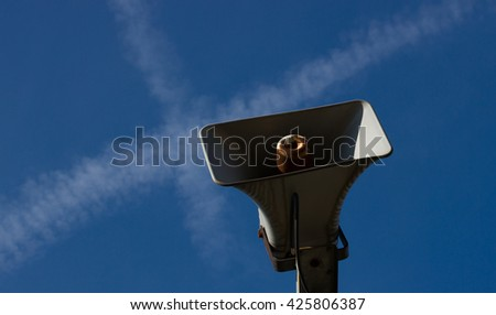 Amplifier - tannoy, speaker - aganinst blue heaven with crossing jet vapor trails. - stock photo