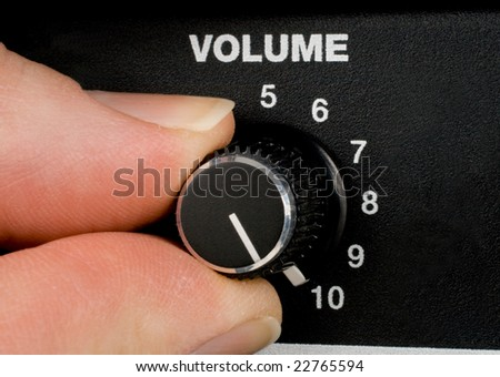 Amplifier volume knob turned to ten - stock photo