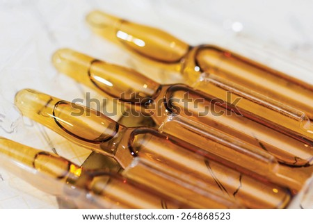 Ampoule, Phials on cardiogram background - stock photo