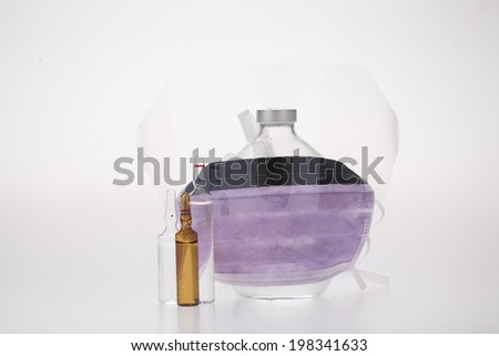 ampule with medical mask - stock photo