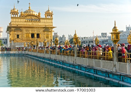 AMRITSAR, INDIA - DECEMBER 17: Sikh pilgrims in the Golden Temple during celebration day in December 17, 2007 in Amritsar, Punjab, India. Harmandir Sahib is the holiest pilgrim site for the Sikhs. - stock photo