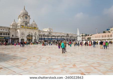 AMRITSAR, INDIA - JANUARY 26, 2015: Entrance and newly constructed (2015) esplanade at the Golden Temple (Harmandir Sahib) in Amritsar, Punjab, India on January 26, 2015 in Amritsar. - stock photo