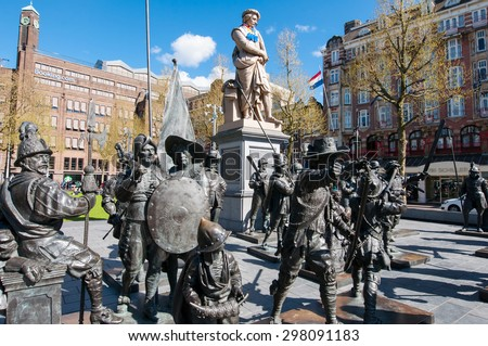 Amsterdam-April 30: Bronze-cast representation The Night Watch, by Russian artists Mikhail Dronov and Alexander Taratynov on Rembrandtplein on April 30, 2015, the Netherlands. - stock photo