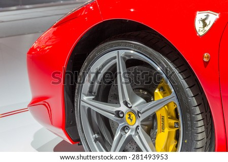 AMSTERDAM - APRIL 16, 2015: Ferrari 458 Spider close up at the AutoRAI 2015. The 458 replaced the Ferrari F430 in 2009 and is now replaced by the Ferrari 488 GTB which was unveiled in Geneva 2015. - stock photo