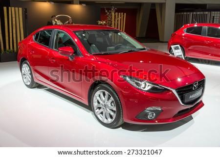 AMSTERDAM - APRIL 16, 2015: Red 2014-model Mazda 3 car at the AutoRAI 2015. - stock photo