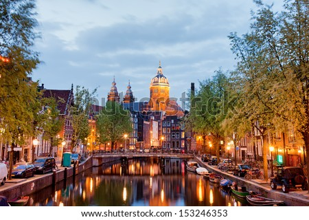 Amsterdam at dusk in Netherlands, North Holland province. - stock photo