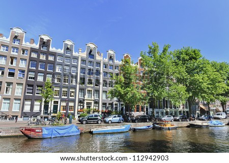 AMSTERDAM-AUG. 18: Ancient gabled houses on Aug. 18, 2012 in Amsterdam, The Netherlands. It is known as Venice of the North, its beautiful canal belt was finally added to the world heritage list in July 2010. - stock photo