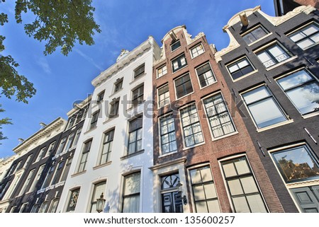 AMSTERDAM-AUG.18. Ancient gabled mansions. Amsterdam is known as Venice of the North, its beautiful canal belt was finally added to the world heritage list in July 2010. Amsterdam, Aug. 18, 2012. - stock photo