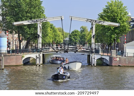 AMSTERDAM-AUG. 19, 2012. Drawbridge on Aug. 19, 2012 in Amsterdam. It is known as Venice of the North. The city has 1,200 bridges and 165 canals. Best way to experience them is one of the boat tours. - stock photo