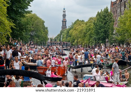 AMSTERDAM - AUGUST 2: A large crowd gather at the Amsterdam canals to watch 'Gay Pride 2008', an event held on august 2th, 2008, in Amsterdam, Netherlands - stock photo