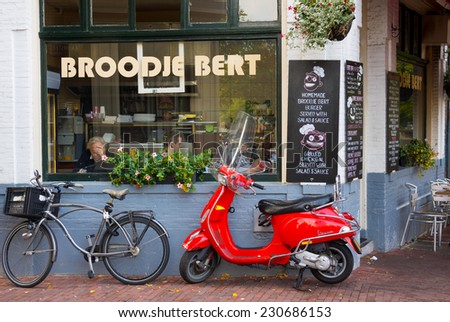 AMSTERDAM - AUGUST 29: Cofeeshop exterior at daytime on August 29, 2014 in Amsterdam. - stock photo