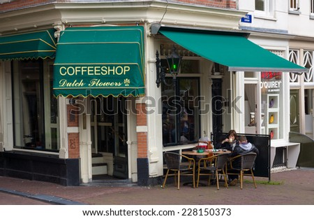 AMSTERDAM - AUGUST 26: Coffeeshop exterior at daytime on August 26, 2014 in Amsterdam. - stock photo