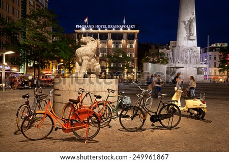 AMSTERDAM - AUGUST 21: Dam Square at Night on August 21, 2012 in Amsterdam, Netherlands. Notable buildings and frequent events in Dam Square make it one of the most important locations in the city. - stock photo