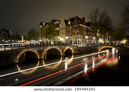 Amsterdam by night, long exposure with light trails - stock photo