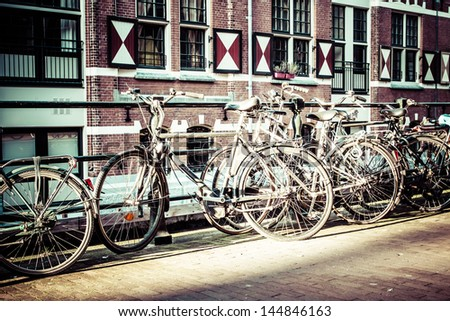 Amsterdam canal and bikes - stock photo