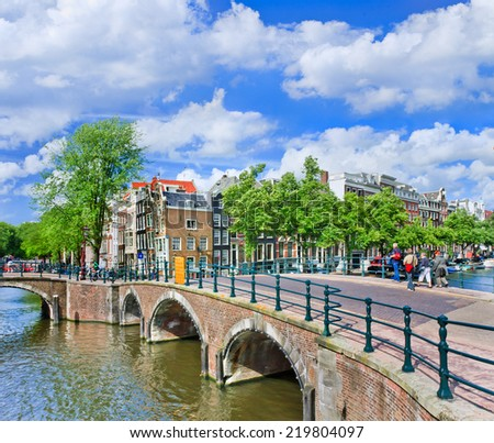 Amsterdam canal belt with ancient bridges and step gabled mansions, Amsterdam, The Netherlands - stock photo
