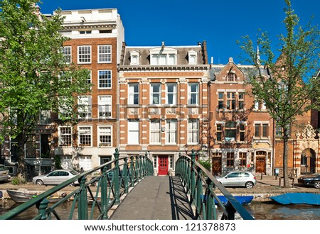 Amsterdam canal bridge and typical houses - stock photo