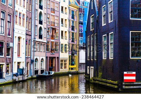 Amsterdam canals and typical houses - stock photo