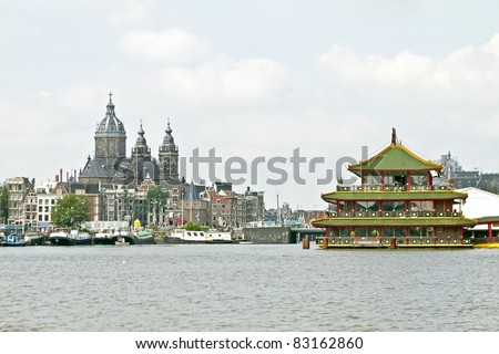 Amsterdam city view with the St. Nikolaas Church - stock photo