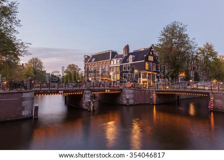 Amsterdam cityscape at dusk twilight - stock photo