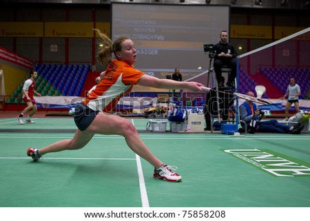 AMSTERDAM - FEBRUARY 19: Ella Diehl beats Patty Stolzenbach (pictured) in the quarter-finals of the European Team Championships badminton in Amsterdam, The Netherlands on February 19, 2011. - stock photo