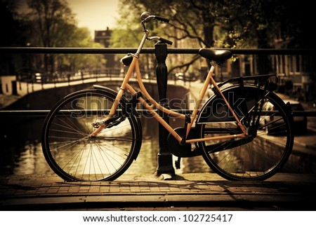 Amsterdam, Holland, Netherlands. Romantic canal bridge, retro bike. Old town - stock photo