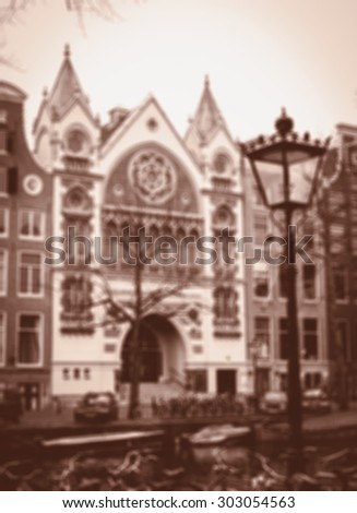 Amsterdam houses over the canal, streetlight, bikes and boats. Blurred aged photo. Sepia. - stock photo