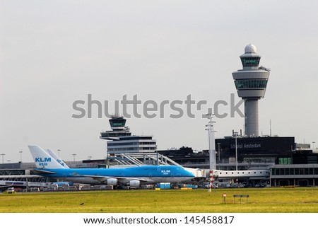 AMSTERDAM - JULY 02: Amsterdam Airport Schiphol in Netherlands on July 04, 2012. AMS is the Netherlands' main international airport, located southwest of Amsterdam. - stock photo