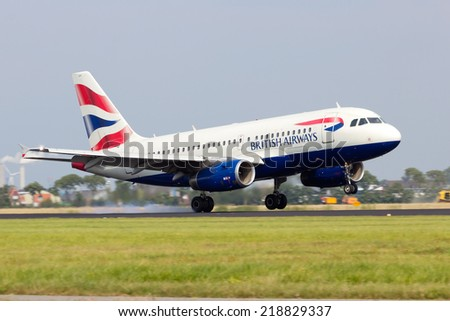 AMSTERDAM - JULY 31: British Airways Airbus A318 arriving at Schiphol on July 31, 2014 Amsterdam, The Netherlands. British Airways is one of the oldest airlines and rated top 3 biggest in Europe. - stock photo