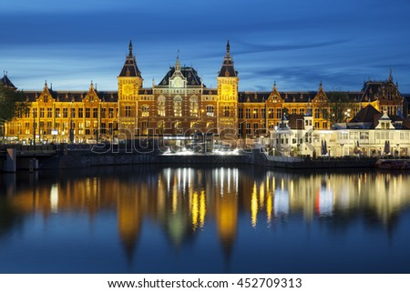 AMSTERDAM - JULY 6, 2016: Central Station on July 6, 2016 in Amsterdam. Central Station is the central railway station of Amsterdam and is used by 250,000 passengers a day. - stock photo