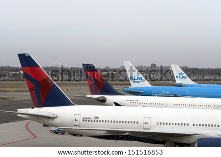 AMSTERDAM,MAART 3 :KLM  and Delta airline plane at Schiphol Airport March 3, 2013 in Amsterdam,The Netherlands. - stock photo